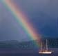 Sailboat at the end of a rainbow in New Zealand