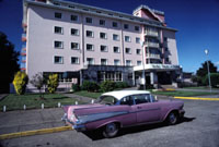 1957 Chevrolet parked in front of hotel in Chile